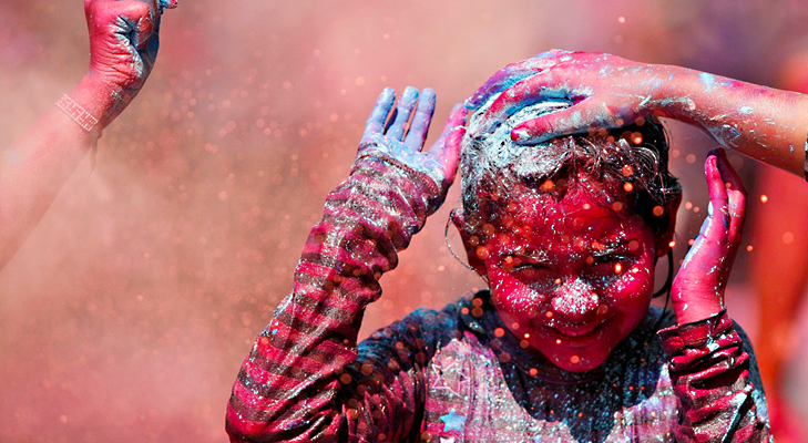 A child enjoys the colour being smeared on her hair during Holi, in Chennai. @TheRoyaleIndia