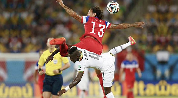 Jermaine Jones (13) of the U.S. jumps for the ball against Ghana's Daniel Opare during their 2014 World Cup Group G soccer match at the Dunas arena in Natal @TheRoyaleIndia