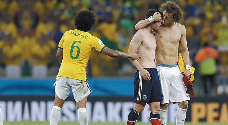 James Rodríguez consoled by David Luiz after Colombia lost to Brazil @TheRoyaleIndia