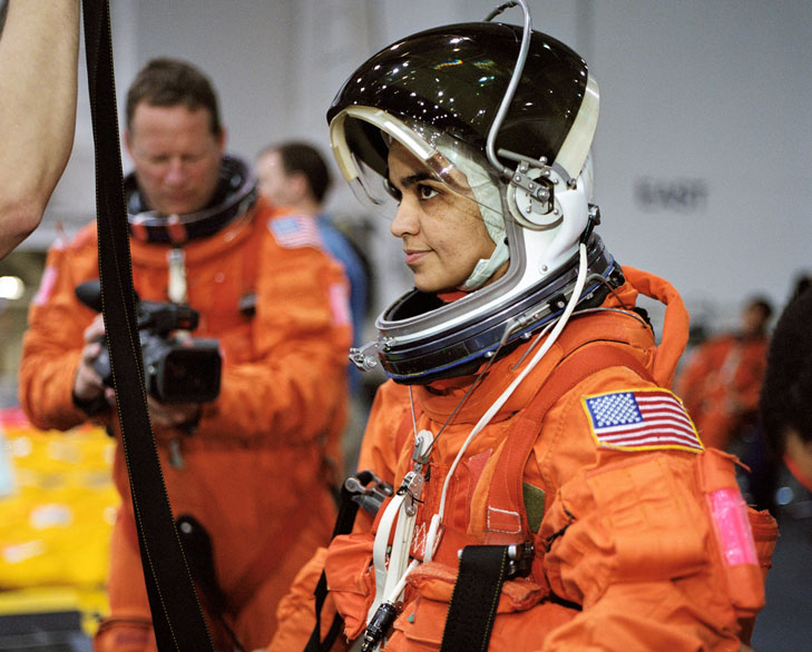 an astronaut in her space suit weighs 300 - photo #18