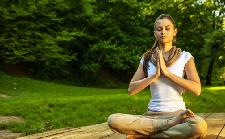 Young female meditate in nature @TheRoyaleIndia